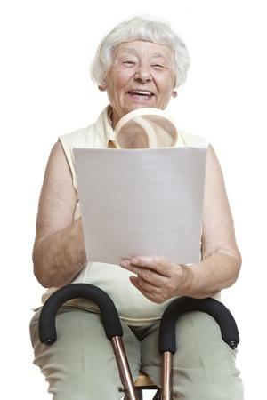 old letters: Happy senior reading letter