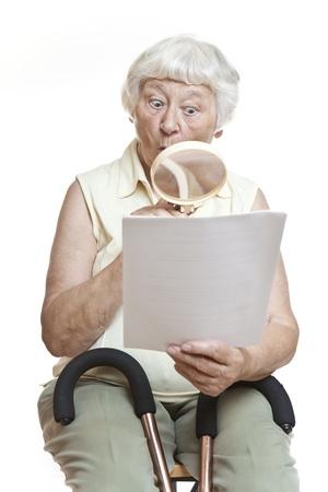Surprised senior reading letter  photo