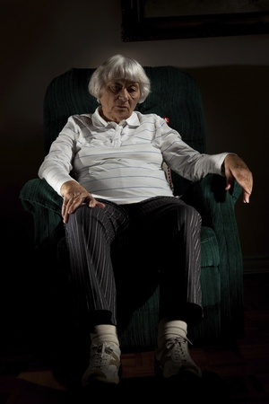 arm chair: Lonely senior woman  Stock Photo