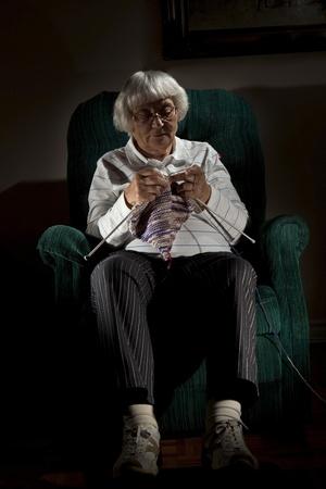 Senior woman knitting  photo