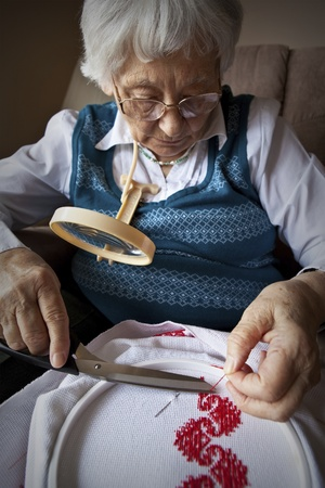 independently: Active senior woman embroidering