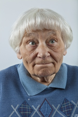 bewildered: Forgetful senior woman head and shoulders portrait   Stock Photo