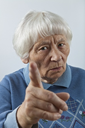 reminding: Scolding senior woman head and shoulders portrait   Stock Photo