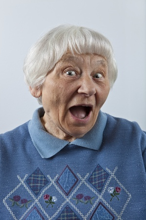 Happy surprised senior woman head and shoulders portrait   photo