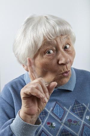 Reminding senior woman head and shoulders portrait