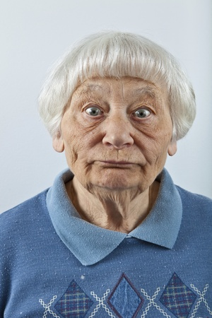 stunned: Goofy senior woman head and shoulders portrait   Stock Photo