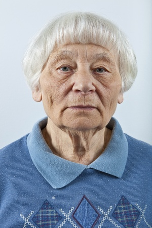 Serious senior woman head and shoulders portrait  photo
