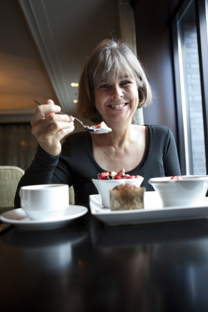 Woman enjoying a healthy breakfast  photo