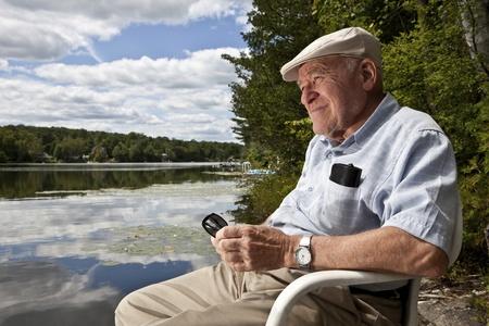 Senior man enjoying a day at the lake  版權商用圖片
