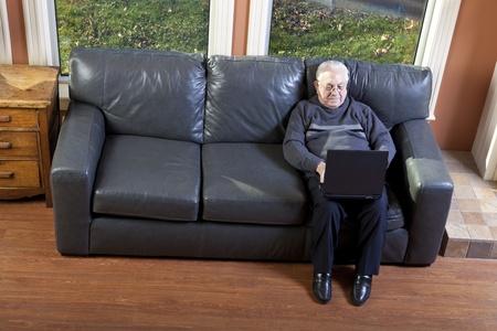 Senior man using laptop Stock Photo - 11239327