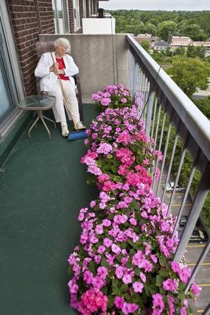 brooming: Senior woman siesta (Outdoor balcony)  Stock Photo