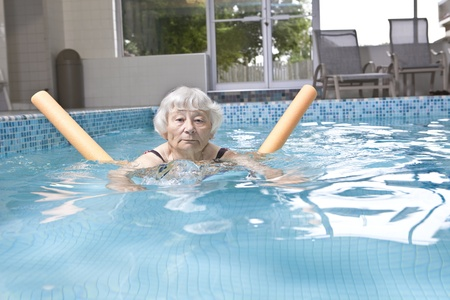 independently: Senior woman aqua fitness