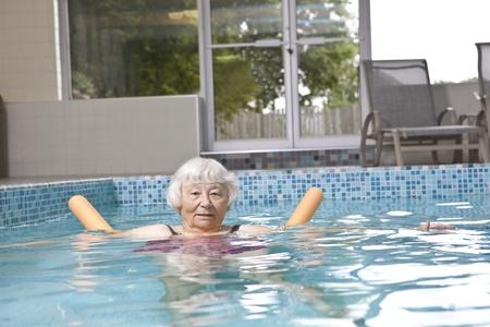 assisted: Senior woman aqua fitness
