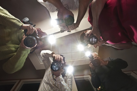 Paparazzi Photographers Shooting a Victim of Crime  photo