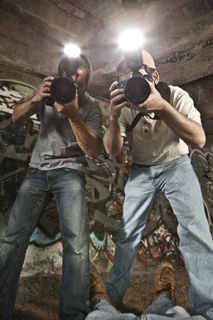 Paparazzi Photographers Shooting a Murder Victim  Banque d'images