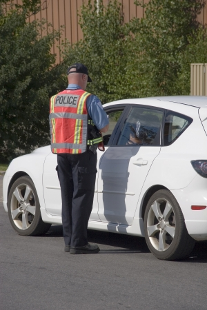 police equipment: Police officer issuing speeding ticket  Stock Photo