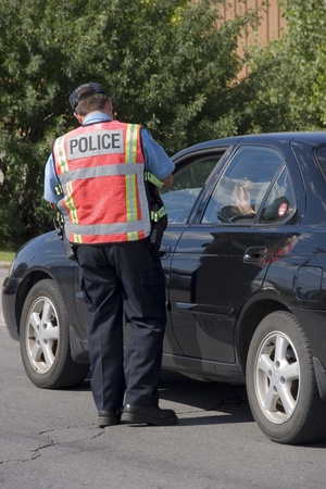 enforcing the law: Police officer issuing speeding ticket  Stock Photo