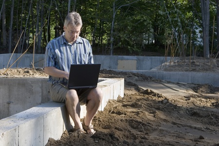 New housing starts man with laptop  photo