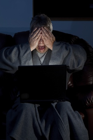 Man in housecoat working late series shocked computer crash Stock Photo - 11552015