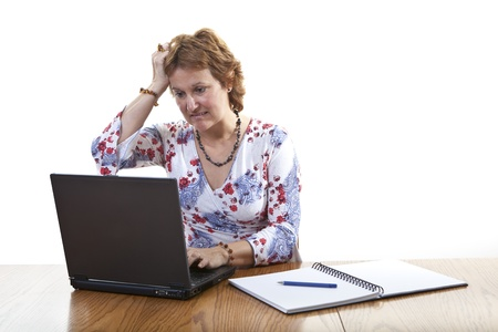 Frustrated businesswoman working on a laptop