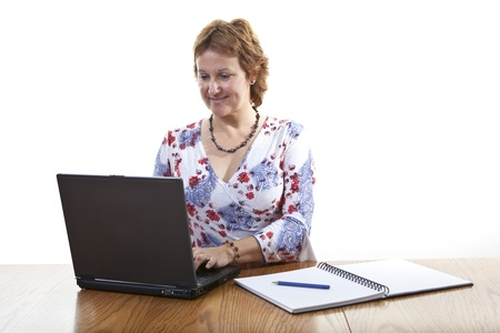 Happy Smiling Businesswoman working on a laptop Stock Photo - 11552002