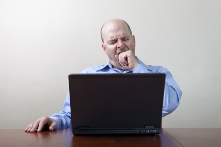 Bored yawning businessman  Stock Photo - 11552007