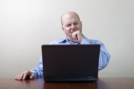 Bored yawning businessman  photo