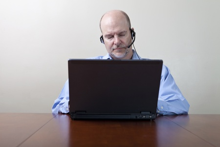 conference call: Bored sleeping businessman  Stock Photo