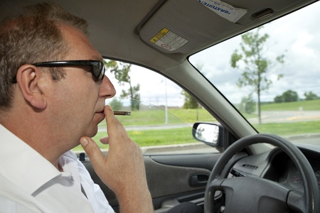Man smoking while driving  photo