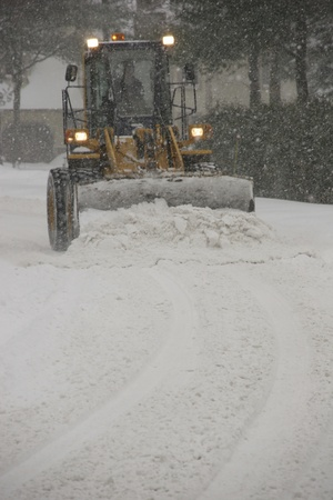 icy conditions: Snow plow cleaning street