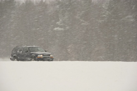 driving conditions: SUV driving during a blizzard