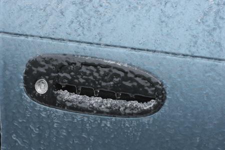 Frozen car door lock due to freezing rain  photo