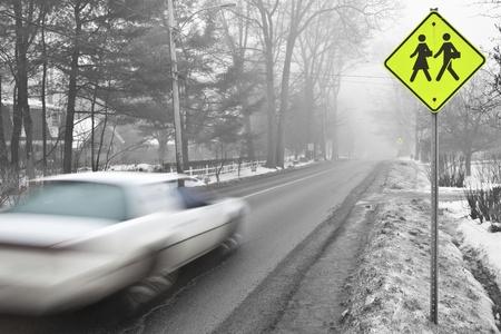 Car speeding in a school zone  photo