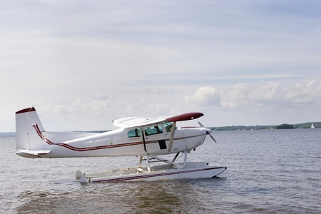 Single engine plane on a lake  photo