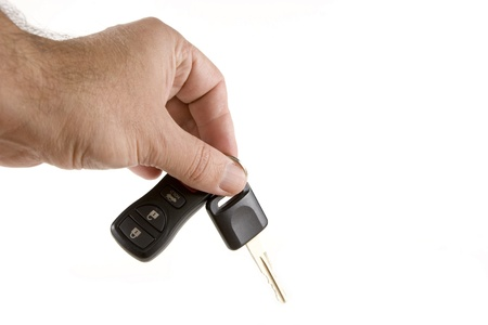 Hand holding car keys  photo
