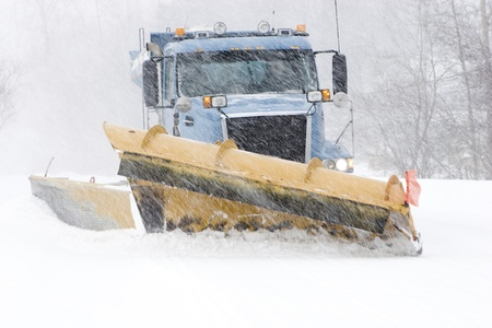 Snow plow cleaning street