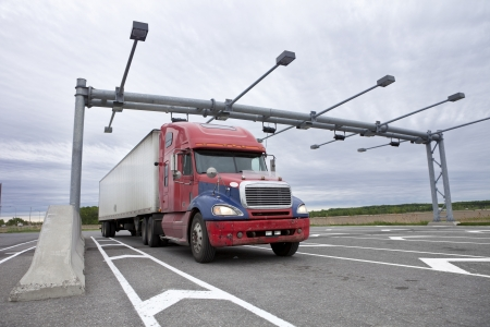Semi truck pulled over at a weigh station  photo