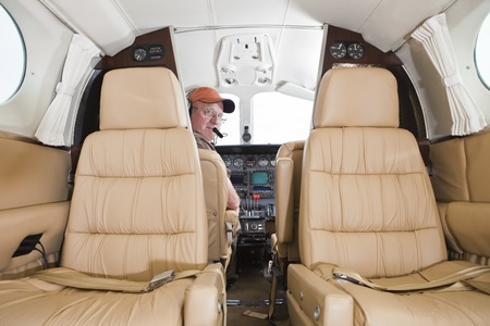 Pilot looking at passenger compartment in a Cessna twin engine  photo