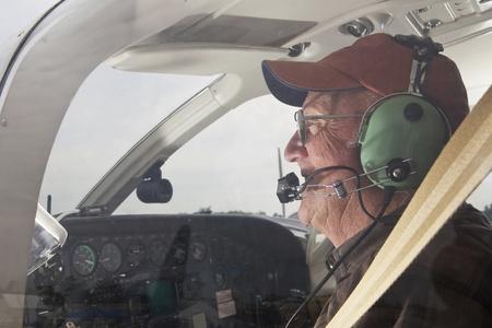pilot cockpit: Senior Pilot in the cockpit of a Cessna twin engine
