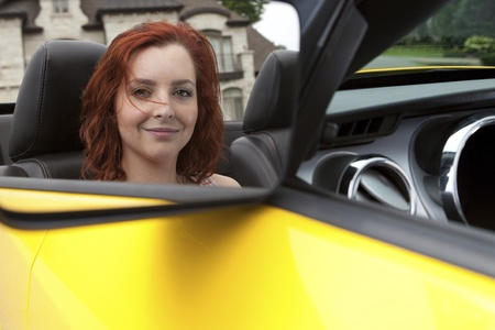 Young woman in a sports car Stock Photo - 11677107