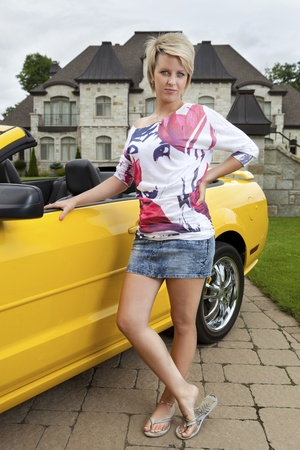 Wealthy young woman standing beside car  Stock Photo - 11677196