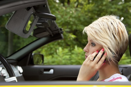 Distracted young woman driving  Stock Photo