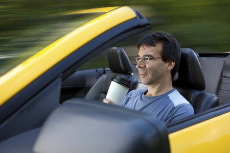 Man drinking coffee while driving  photo