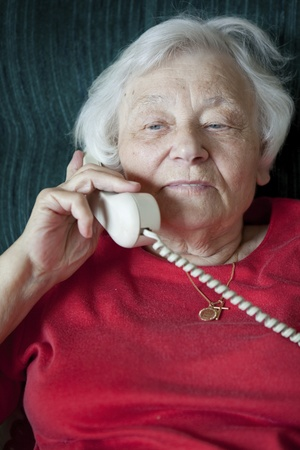 Senior woman talking on the phone  photo