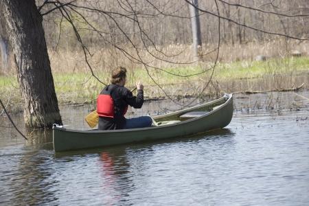 人間の自然の中でカヌー 写真素材