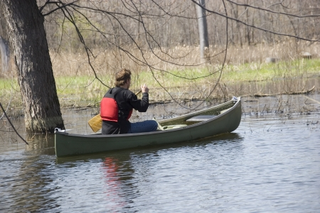 Man canoeing in nature  Stock Photo