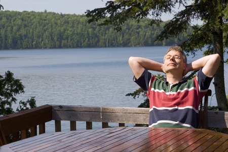 Man relaxing by a lake  photo