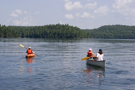 Mother canoeing with her kids  photo