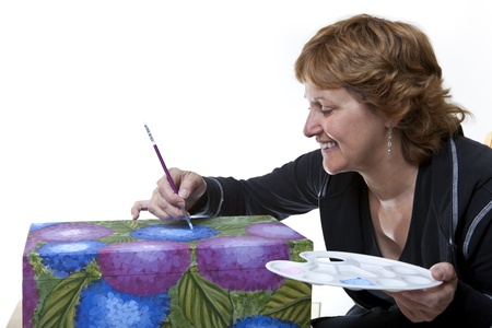 Woman tole painting a wooden box  photo
