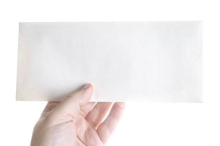 holding close: Hand holding a blank envelope